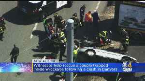 Witnesses Help Rescue Couple Trapped Inside Wreckage Following Crash In Danvers [Video]