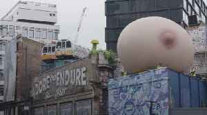 Giant breasts pop up on London rooftops [Video]