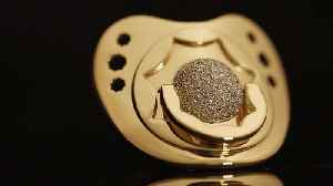 A gold-plated dummy: the bling fit for a British royal baby [Video]