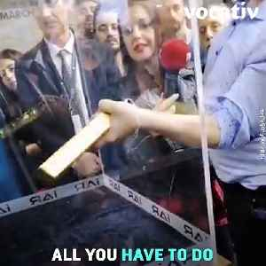 News video: Turkish Competition: If You Can Lift This 25 Pound Gold Bar Out Of A Small Hole One Handed, You'll Win Gold!