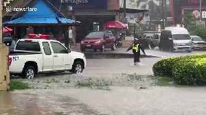 Cars travel through flooded roads in Thai city [Video]