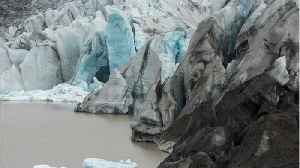 Tourists In Iceland Scramble To Escape An Enormous Wave Caused By Calving Glacier [Video]