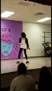 Kid dances to Michael Jackson at school talent show [Video]