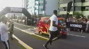 Watch: Usain Bolt jogs to victory in race against tuk-tuk [Video]