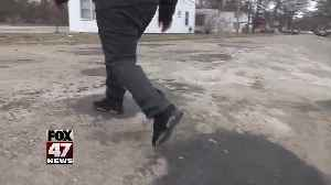 West Michigan boy fixes potholes on his own [Video]