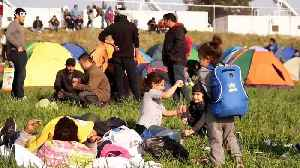 Hundreds of Refugees descend on Greece's northern border with Macedonia to re-open migration route [Video]