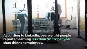 Overweight People Get Paid Less [Video]
