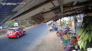 Horrific moment two mopeds smash together in the middle of a busy road [Video]