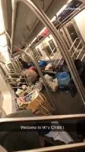 Homeless man puts all his trashbags and belongings inside a subway train [Video]
