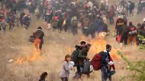 Refugees in Greece start fires as they clash with police in attempt to reach northern border [Video]
