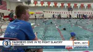 'It's a really amazing feeling': Swimmers dive in to fight slavery worldwide [Video]