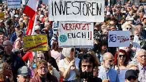Germans take to streets in rent rise protests demanding more homes to become social housing [Video]