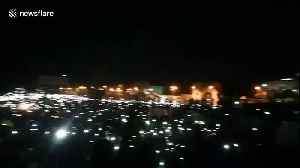 Thousands protest outside Sudan army HQ with phones in the air [Video]
