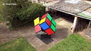 Ingenious UK man solves giant Rubik's Cube from the INSIDE [Video]