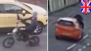 CCTV shows vandal motorbike rider rammed by car in hit-and-run [Video]