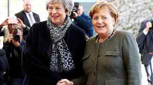 May and Merkel meet as UK parliament passes Brexit delay law [Video]
