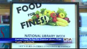 'Food for Fines' helps Lee County Library and the public [Video]