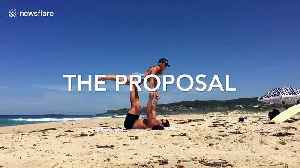 Aussie man makes surprise proposal to his girlfriend during beach 'acro-yoga' [Video]