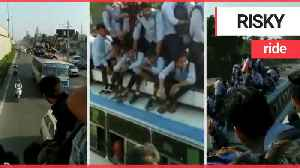 Worrying footage shows kids taking the bus to school - by sitting on the roof [Video]