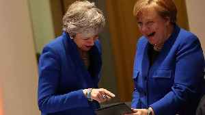 What was on the tablet that had May and Merkel laughing? [Video]