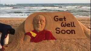 Sand artist in India carves 'Get Well' message for recently ill Dalai Lama [Video]