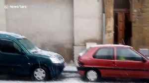 Unseasonal hailstorm pummels cars parked on a street in Barcelona [Video]