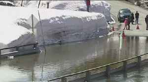 Ice Dam Floods Only Roads To Subdivision [Video]