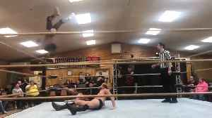 Professional Wrestler Falls out of Ring Attempting Aerial Move [Video]