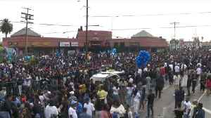 News video: Thousands Line Streets as Procession for Slain Rapper Nipsey Hussle Goes Through South LA