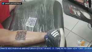 SEE IT: Soccer Fan Gets Barcode Tattoo [Video]