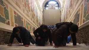 Catholics climb newly-restored holy stairs at Vatican [Video]