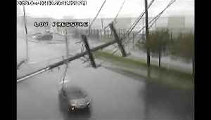 Storm slams utility pole into moving car near Seattle [Video]