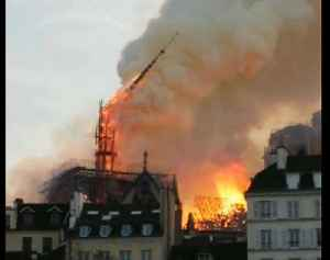Watch: Moment Notre Dame Cathedral's spire comes crashing down amid fire [Video]