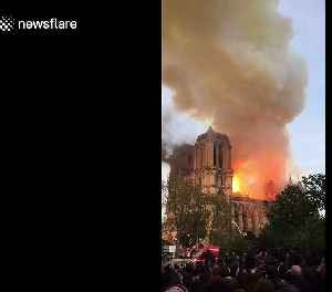 Crowd watches as flames engulf Notre Dame Cathedral in Paris [Video]