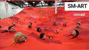 Hundreds of t-shirts collected from Mexico are sown together to create art installation [Video]