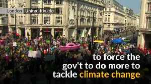 Thousands block London roads in climate change protest [Video]
