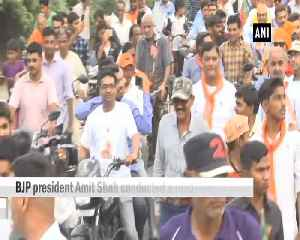BJP Chief Amit Shah conducts roadshow in Gujarats Kalol [Video]