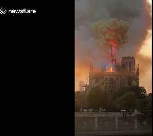 Shocking moment iconic Notre-Dame spire collapses into flames [Video]