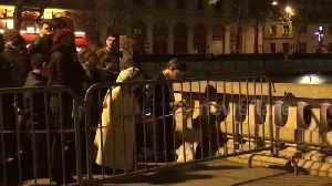 Hymns, prayers as Paris' Notre Dame cathedral burns [Video]