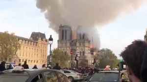 News video: Shocking Footage Shows Moment Notre Dame Cathedral Spire Collapses As Huge Fire Rips Through Building