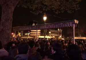 News video: Crowd Laments Burning Notre Dame Cathedral in Paris