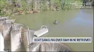 Dangling Pontoon Pulled off Dam [Video]