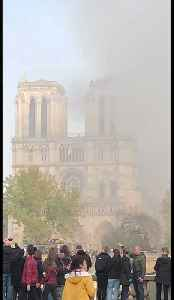 Smoke Seen Pouring From Burning Notre Dame Cathedral [Video]