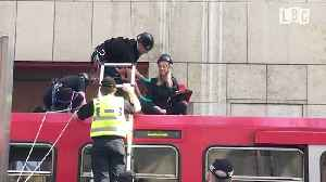 Moment Climate Change Protesters Removed From DLR Train By Police [Video]
