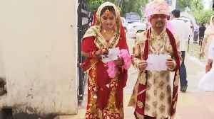 Lok Sabha Elections 2019: Newly-married couple turn up for voting in J&K's Udhampur | Oneindia News [Video]