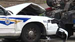 Car crashes into police cruiser leading funeral procession [Video]