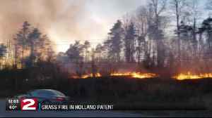 Downed power line caused massive grass fire in Holland Patent [Video]