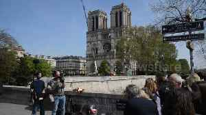 Parisians lay flowers at Notre Dame as forensics enter cathedral [Video]