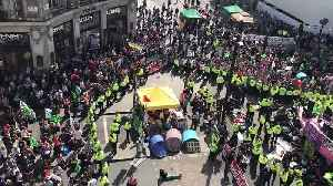 Police Lines Cordon Off Extinction Rebellion Protesters in London's Oxford Circus [Video]