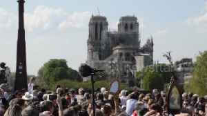 News video: Huge crowd attends Good Friday procession by Notre Dame in Paris